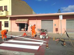 City of Portoscuso (Sardinia) - execution of horizontal road signs.